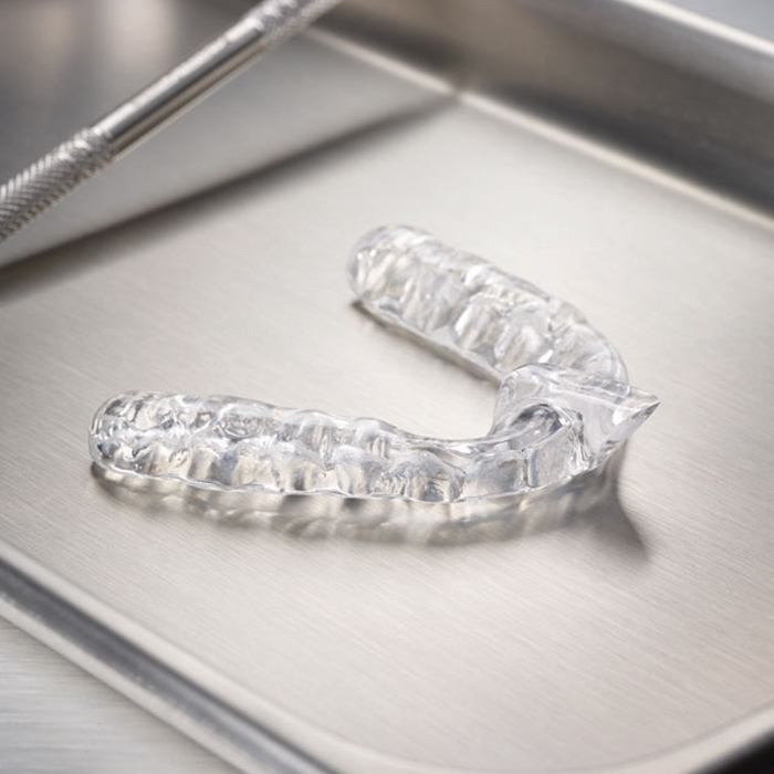 Clear nightguard for bruxism on metal tray