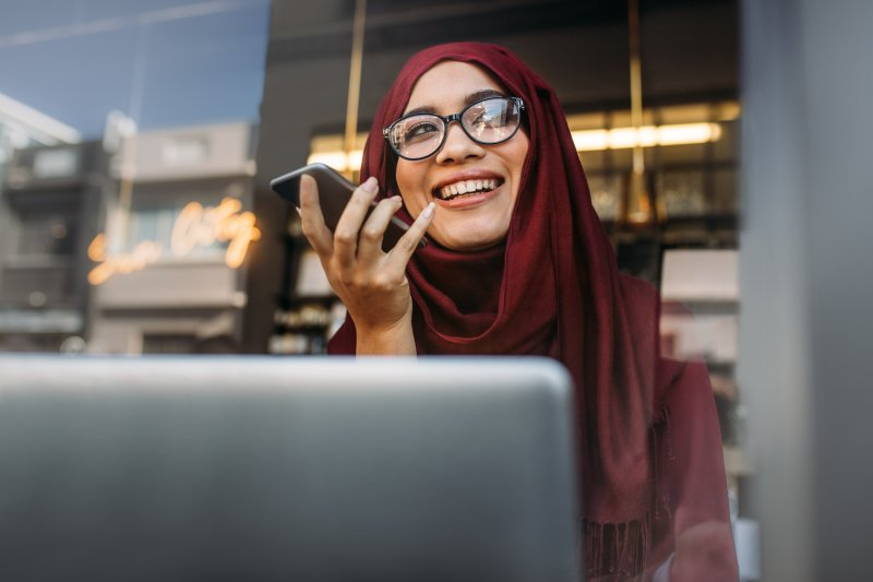 Woman using laptop to look for dentist