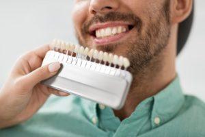 dentist showing patient veneers in frisco
